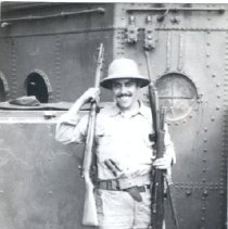 Image of 1985.0069.112 - B&W photo of a Sailor holding three rifles - a knife is in his utility belt