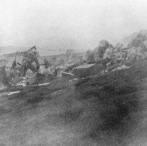 Image of 1985.0098.1 - B&W photo of Marines making beach head at Iwo Jima. UDT 14