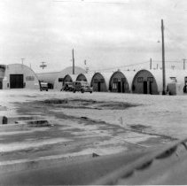 Image of 1999.0019.8 - B&W photo, HQ UDT Pac; UDT-1 and UDT-3 Admin and Training Quonset Huts.  This was the total building structures.  Two other Quonset Huts exist outside the frame of the picture.