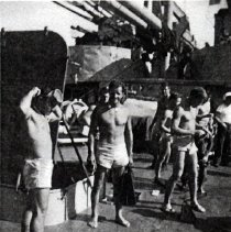 "Image of 1999.0019.2 - B&W photo of UDT's on the USS Wantuck. The USS Wantuck had accidentally stopped in a swarm of Portuguese-Man-O-War. After the first few UDT 1 members had been ""full whipped"" it was a matter of honor for the remaining members to follow their teammates"