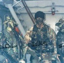 2001 0169 1 - Color photo of SEAL Team 8 preparing for Haiti on Ship