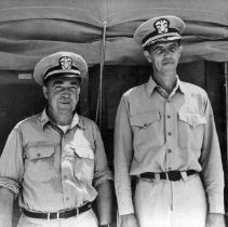 Image of 2002.0130.23 - B&W photo of Lt. William Flynn (L) and Draper Kauffman (R) in Ft. Pierce.