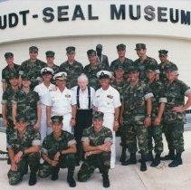 """Image of 2002.0061.2 - Color group photo of SEAL Team 4 at Muster XV, with CMDR """"Red Dog"""" Fane. Nov 10, 2010"""
