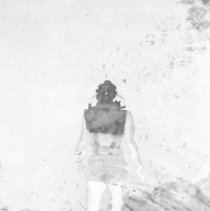 Image of 2002.0101.4 - B&W photo of Early rebreather used in OSS movie in 1942.