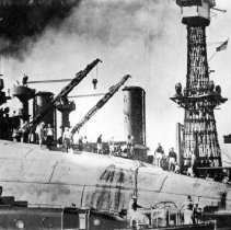 Image of Burning holes in side of U.S.S. Oklahoma to remove men trapped below.
