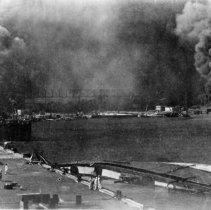 Image of USS Shaw, rt ctr; USS Oglala, on side in front; USS Helena, lt ctr.