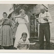 Image of 2009-012.KGJ009 - Kelley Family enjoying Watermelon, Fall City 1915