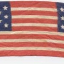 """Image of 2011-006.AK159 - Narrow ribbon, silk?, with """"stars and stripes"""" pattern, Artie Kelley"""