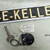 Image of 2011-006.JSK232b - Metal business sign and school keys, Jesse Kelley, Fall City