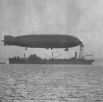"Image of P2004M.317 - Dirigible (Navy: Aircraft thought to be dirigible ""Los Angeles"" moored to oiler ""Patoka"")"