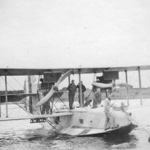 Image of P2004M.406 - Seaplane (Navy, Aircraft: Sea plane [casting off] mooring in Potter Cove)
