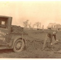 Image of P2012.040.003 - Parker Armbrust shoveling dirt at Beavertail Farm