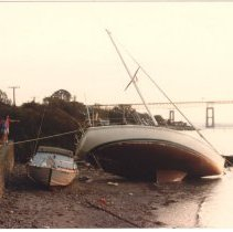 Image of P2015.005.007 - Hurricane Gloria - sailboat washed up at seawall at East Ferry