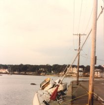 "Image of P2015.005.009 - Hurricane Gloria - power boat ""Crafty Lady"" and sailboat washed up at seawall at East Ferry"
