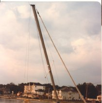 Image of P2015.005.010 - Hurricane Gloria - sailboat washed up at seawall at East Ferry