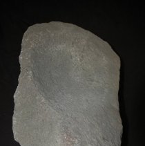 Image of Metate, basin, granitic. Ventral vertical view, end A.