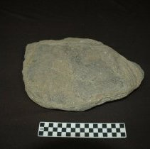 Image of Metate, basin, fragment, granitic. Dorsal horizontal view, base.