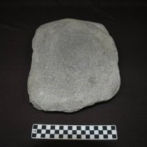 Image of Metate, basin, fragment, granitic. Ventral vertical view, end A.