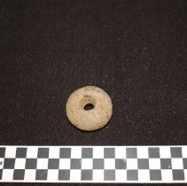 Image of Gabbro Doughnut Stone--view A, dorsal side with perforation.