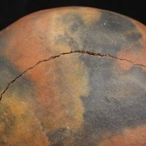 Image of Wide crack on bottom of pot.