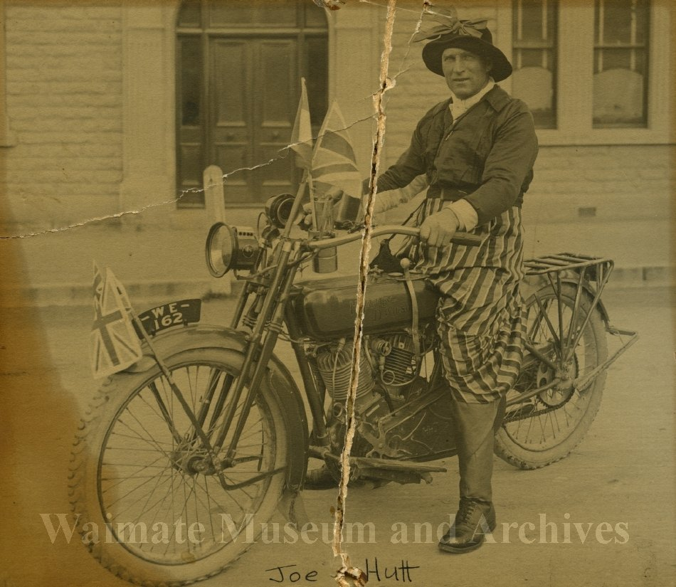 Joe Hutt on motorcycle in WWI Peace Celebration parade. - Waimate Museum and Archives