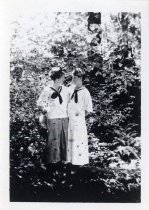 Image of Two young women in a forest, circa 1914-1929