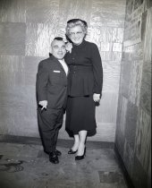 Image of Midget wrestler posing with woman, c. 1950