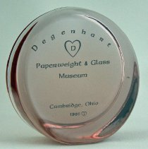 Image of Mosser Glass round upright paperweight.