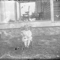 Image of FW_12499 - Child sitting outside