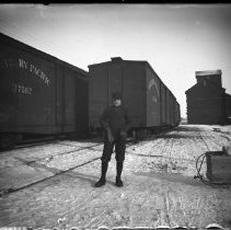 Image of FW_13237 - Boy Standing by N.P. Trains in Winter