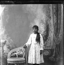 Image of FW_01899 - Child Standing in Formal Dress by a Chair