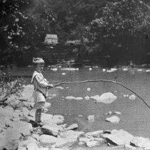 Image of Little boy fishing on Elkhorn Creek - 2003.49.2