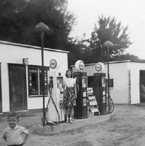 Image of Claurde Burchfield's Pure Oil Filling Station on Holmes Street - 2005.200.1