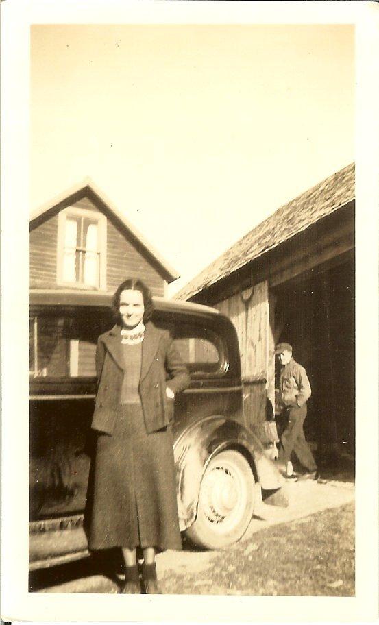 Elizabeth Harkins standing by a car, 1936