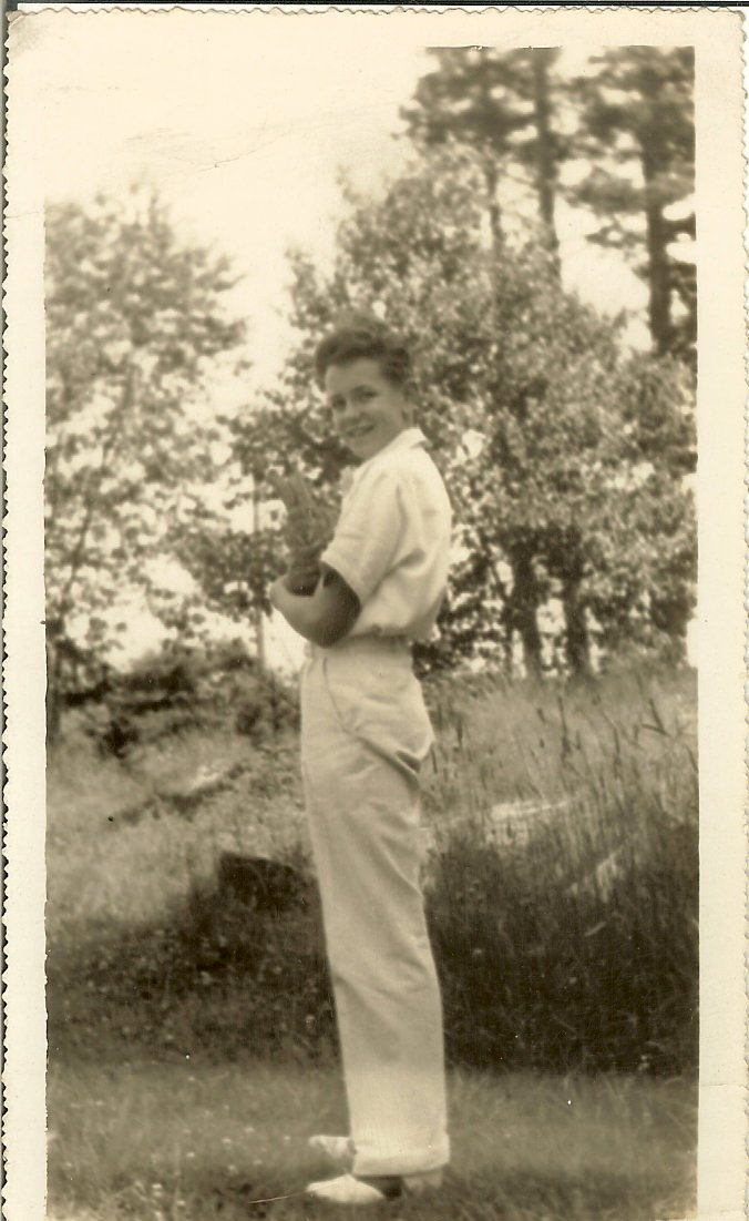 young Paul Hinton with cat