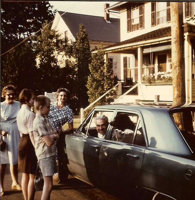 Albert Gott parked in car with family around