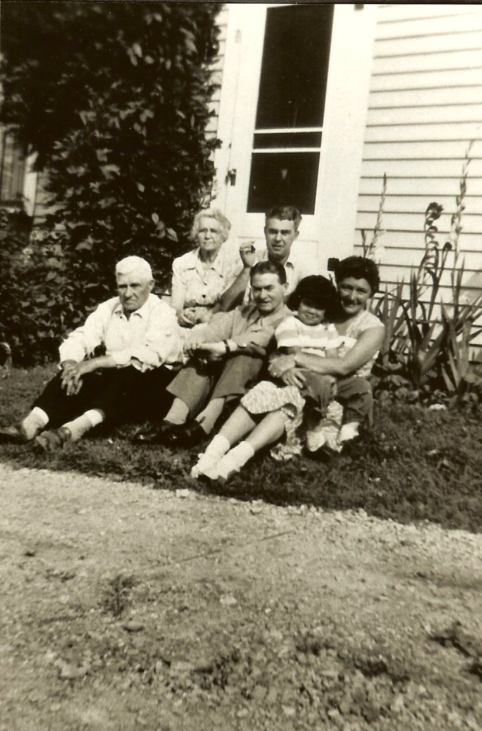Sylvester, Esther, & Albert Gott, Frank O'Kane & young Betsy Nelson in the lap of Evelyn Gott's friend.
