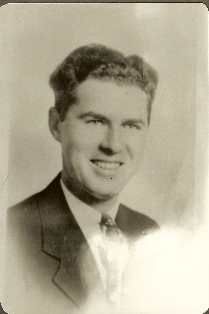 Albert Gott in suit & tie, professional photo