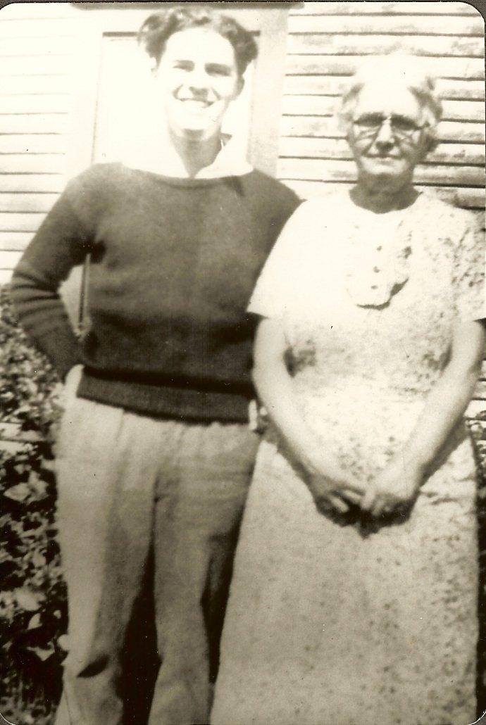 Albert & Esther Gott standing outside