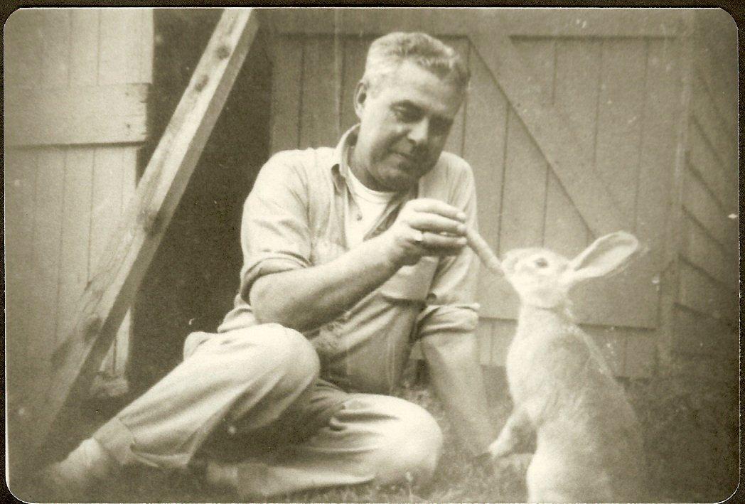 Albert Gott feeding a rabbit