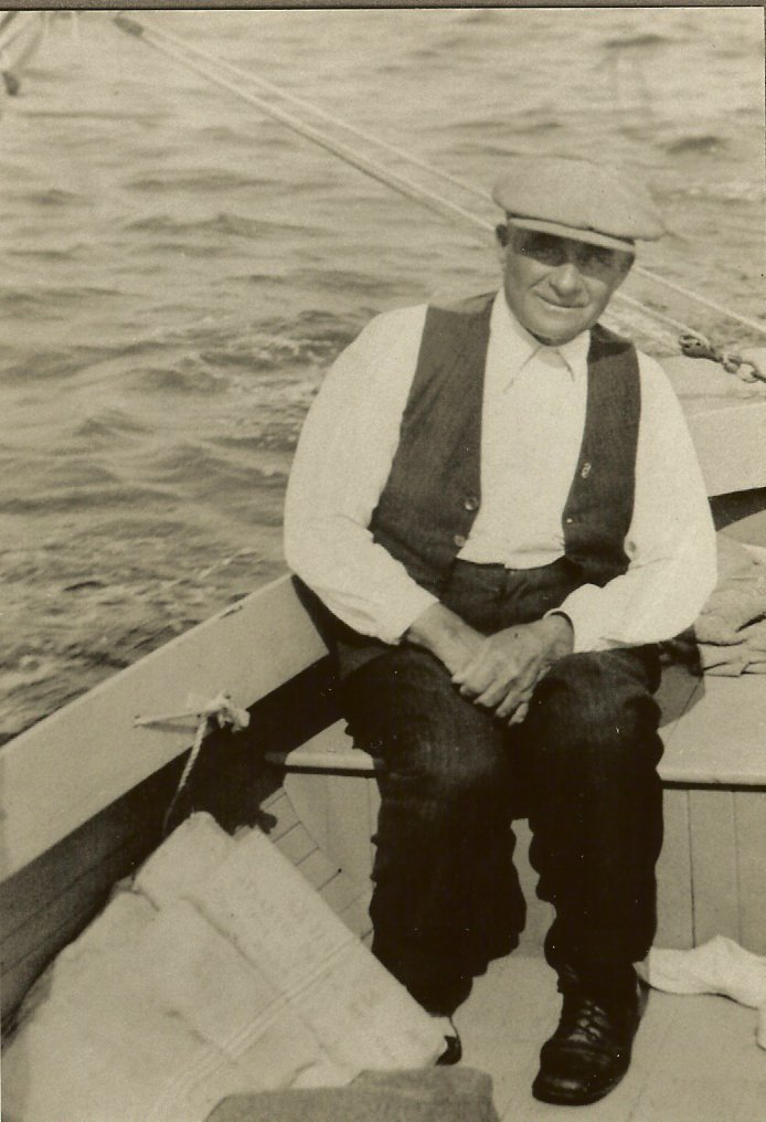 Sylvester Gott at the helm of a sailboat