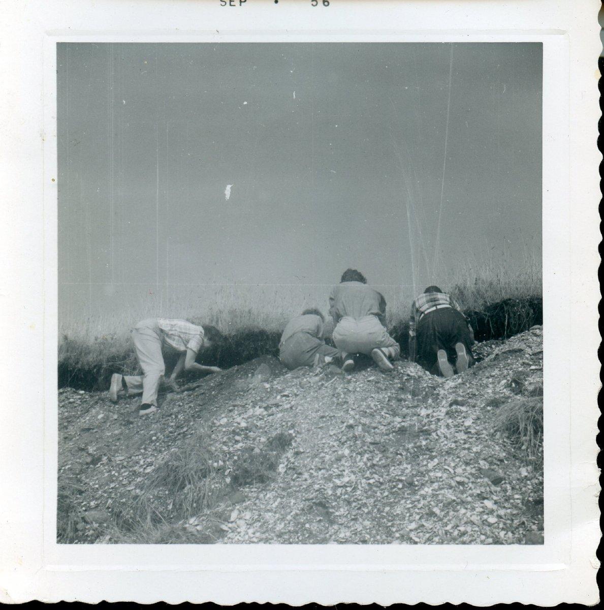 Moore, Ruth & friends exploring shell heap at Orono island Sep, 1956