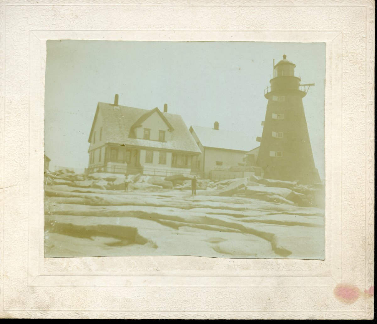 Mount Desert Rock lighthouse, keepers in foreground.