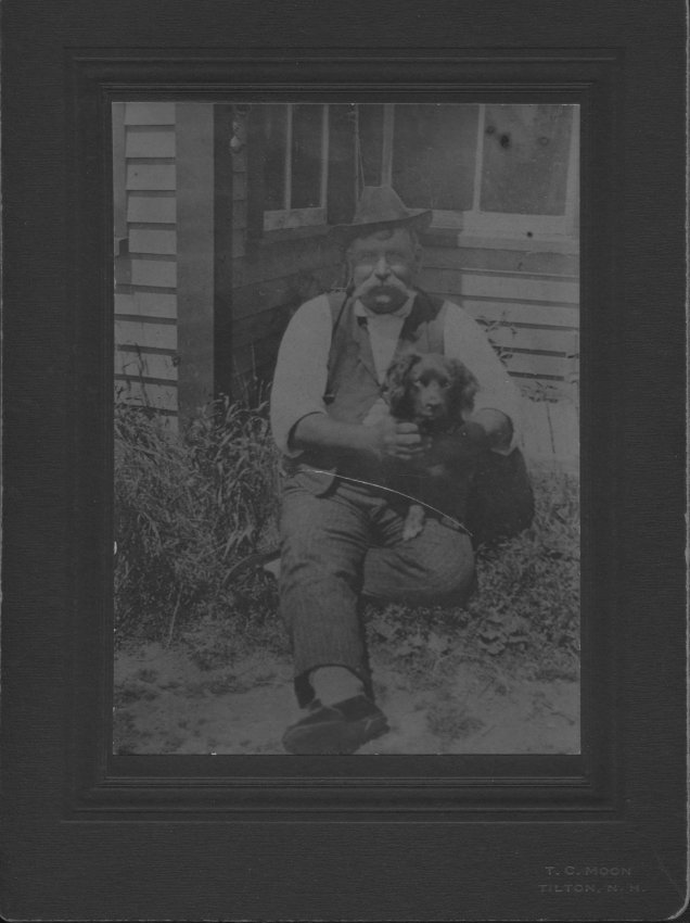 Trask, Lorenzo S., and his dog, sitting outside