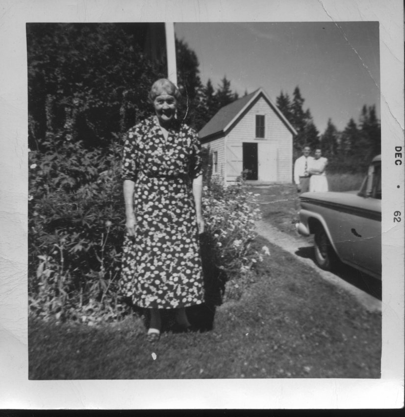 Emily Maria Rich in front of her garage on Lopaus Pt.