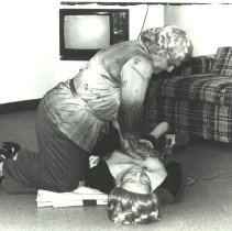 Image of Mary Brynner Practicing CPR on a First Aid Dummy -