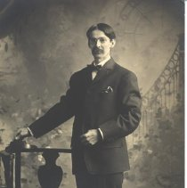 Image of Man Standing By Chair - Harriet Fish Collection
