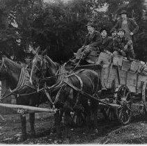 Image of Five Men Haul Wood -