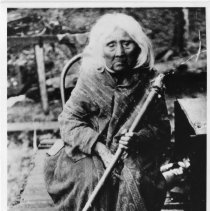 Image of Mary Louie Sitting With Cane -