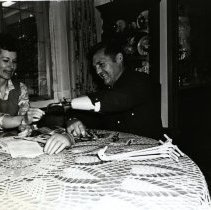 Image of Bessie and Bob Burton Seated at a Table -